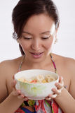 Beautiful woman and fruit salad Royalty Free Stock Image