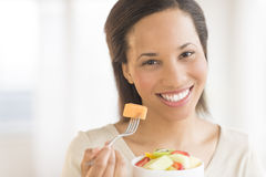 Beautiful Woman With Fruit Salad At Home Stock Photography