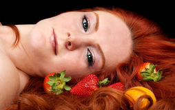 Beautiful   woman with fruits in  red hair Royalty Free Stock Images