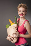 Beautiful woman with  fruits and vegetables Stock Image