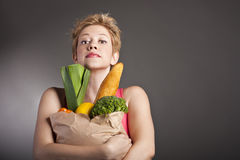Beautiful woman with  fruits and vegetables Stock Images