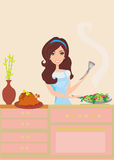 Beautiful woman frying  in kitchen Stock Image
