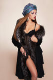 Beautiful woman in fur and arabic turban Royalty Free Stock Photo
