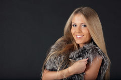 Beautiful woman in fur cloths Stock Image