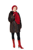 The beautiful woman in a fur-coat Stock Photo