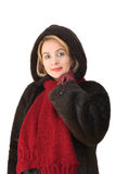 The beautiful woman in a fur-coat Royalty Free Stock Photos