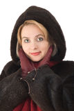 The beautiful woman in a fur-coat Stock Photography