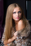 Beautiful woman in a fur coat Stock Image