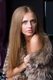 Beautiful woman in a fur coat. Portrait of beautiful woman in a fur coat Stock Image