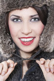 Beautiful woman in a fur coat Stock Photography