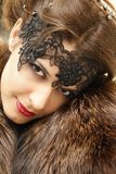Beautiful woman in the fur coat Royalty Free Stock Photography