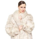 Beautiful Woman in a Fur Coat. Close up portrait of a beautiful woman in a fur coat Royalty Free Stock Photography