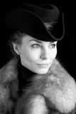 Beautiful woman with fur coat and hat. Picture of a beautiful woman with fur coat and hat Stock Photos