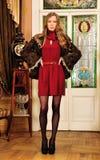 Beautiful woman in fur coat in the interior Royalty Free Stock Photo