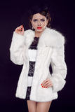 Beautiful woman in fur coat. Jewelry and Beauty. Fashion photo Stock Image