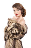 Beautiful woman in fur coat Stock Photo