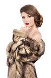 Beautiful woman in fur coat. Looking at camera Stock Photo