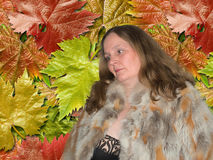 Beautiful woman with fur coat posing in front of camera Stock Images