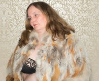 Beautiful woman with fur coat posing in front of camera Royalty Free Stock Photos