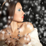 Beautiful woman in fur with folling snow Royalty Free Stock Image