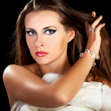Beautiful woman in fur with hand in hair Royalty Free Stock Image