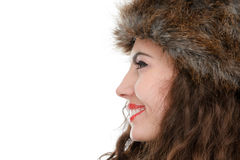 Beautiful woman in fur hat. Studio isolated on white background Royalty Free Stock Photos