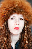 Beautiful woman in fur hat Stock Images