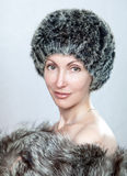 Beautiful woman in a fur hat. The young beautiful woman in a fur hat Royalty Free Stock Photo
