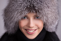 Beautiful woman in a fur hat Royalty Free Stock Photos