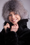 Beautiful woman in a fur hat Royalty Free Stock Images