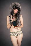 Beautiful woman in a fur hat Royalty Free Stock Photography