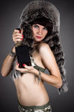 Beautiful woman in a fur hat Stock Photo
