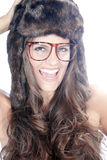 Beautiful woman with fur hat and glasses Royalty Free Stock Images