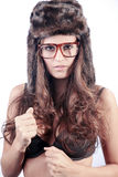 Beautiful woman with fur hat and glasses Royalty Free Stock Image