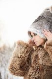 Beautiful woman in fur hat.outdoor. Fashion beauty outdoor portrait of young woman in fur hat. beautiful model girl in snow winter forest Royalty Free Stock Photography