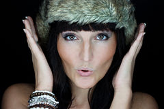 Beautiful woman with fur hat Stock Photography