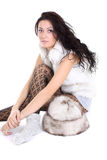 Beautiful woman with fur hat  sitting Royalty Free Stock Photography