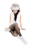 Beautiful woman in fur hat  sitting Stock Photos