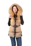 Beautiful woman in fur trimmed jacket. Beautiful smiling woman in fur trimmed jacket with hood keeping warm against the winter cold isolated on white Stock Photography