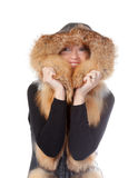 Beautiful woman in fur trimmed jacket. Beautiful smiling woman in fur trimmed jacket with hood keeping warm against the winter cold isolated on white Royalty Free Stock Photo