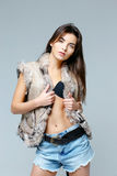 Beautiful woman in a fur vest Stock Photography