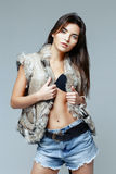 Beautiful woman in a fur vest Royalty Free Stock Photos