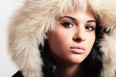 Beautiful woman with fur. white fur hood. winter style. make-up. fashion beauty girl. Stock Photo