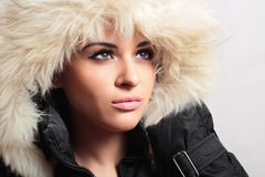 Beautiful woman with fur. white fur hood. winter style. make-up. fashion beauty girl. Stock Images