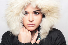 Beautiful woman with fur. white hood. winter style.make-up Stock Photo
