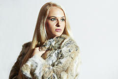 Beautiful woman in fur.winter fashion.Beauty blond Girl in Rabbit Fur Coat Royalty Free Stock Images
