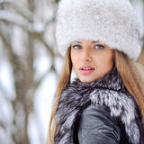 Beautiful woman in furry hat in winter - close up Stock Images