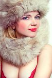 Beautiful woman in furs and bra Stock Photos