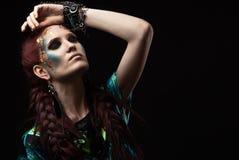 Beautiful woman with futuristic make-up posing Stock Photos