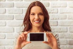 Beautiful woman with gadget Royalty Free Stock Photos